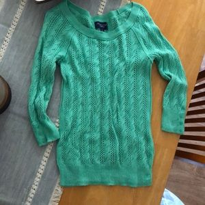 Green cablenet sweater